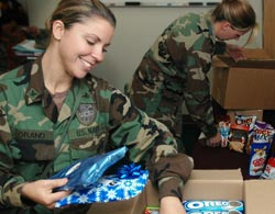 Military member receiving holiday care package.