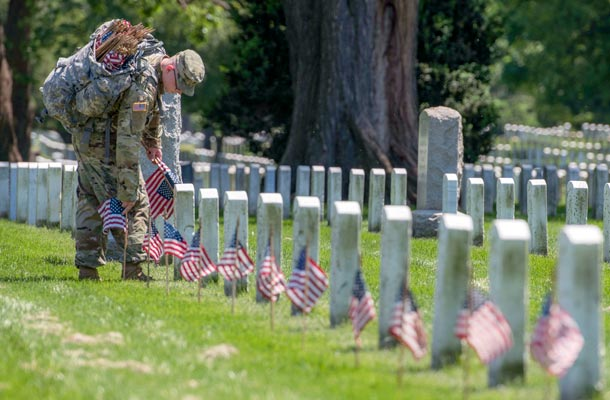 USBA Memorial Day eCard 2019 - soldier placing flags at cemetery